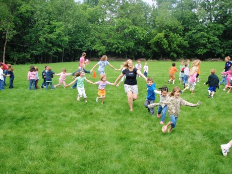 Children Play Games Outside With Grownups