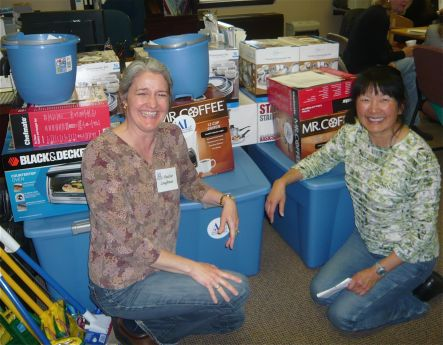 Operation New Start co-chair Heather Laughman (left) prepares for a kitchen delivery with former co-chair Phyllis Young