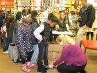 Students' feet were measured before they searched for the pair of shoes they wanted. (Mary Owen/Tribune)