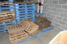 Some of the 200 sewer grates recovered Thursday at a Romeoville scrap yard. (Joliet Police Department)