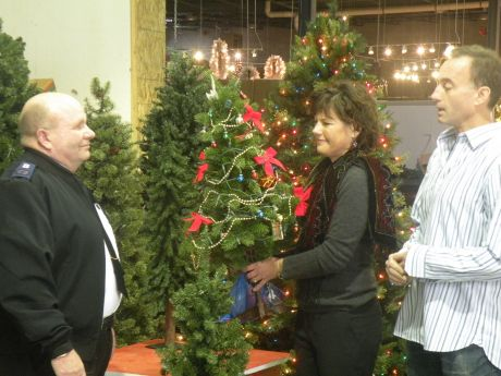 (left to right) Envoy Dennis Earnhart of The Salvation Army accepts a  donation of - Area Residents Donate 120+ Christmas Trees To Families In Need