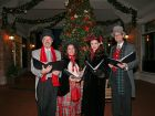 After the Electric Lights Parade on Friday, the Classic Ring Carolers entertained visitors near the Main Street Promenade holiday tree in downtown Naperville.