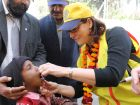 Nicki Scott, former president of the Rotary Club of Naperville Sunrise, administers the polio vaccine to a child in Sonipat, India, northwest of New Delhi. Scott and a group of 37 Rotarians from the United States and Canada joined thousands of other volunteers in India February 19 to 21 to help with National Immunization Days.