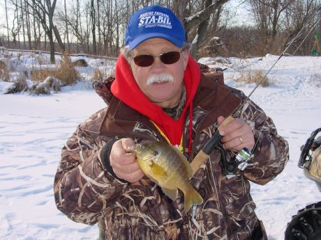 Boulder junction ice fishing cures cabin fever new lenox for Ice fishing show