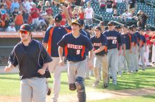 Oak Park players run off the field after beating Grant in the state semifinals. (Jeff Vorva/Tribune)