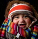 one warm coat baby in multicolor scarf