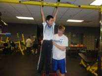 Brandon and Scott working on strength training.
